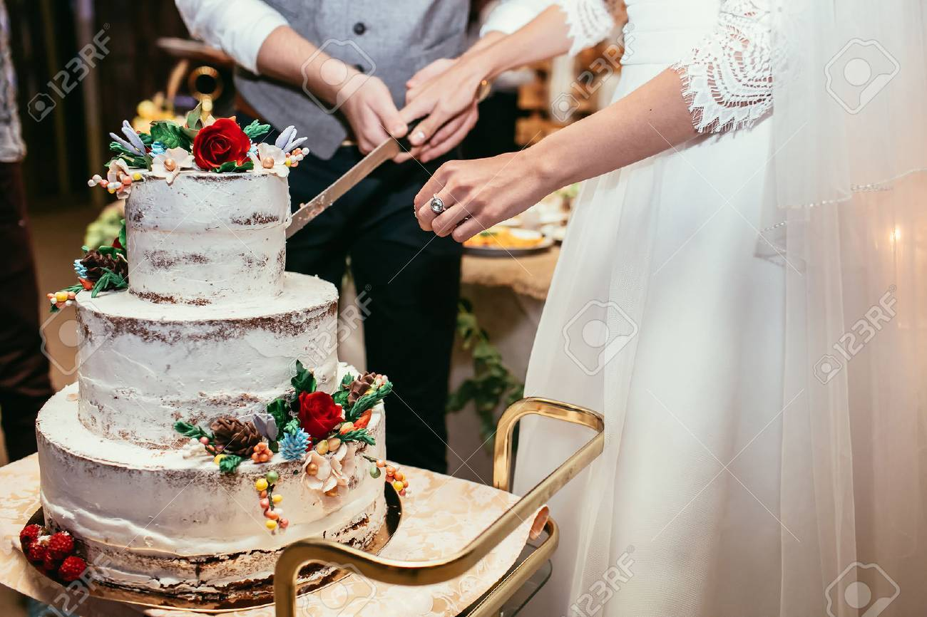 Bride And Groom Cut Rustic Wedding Cake On Wedding Banquet With - Bride Wedding Cake