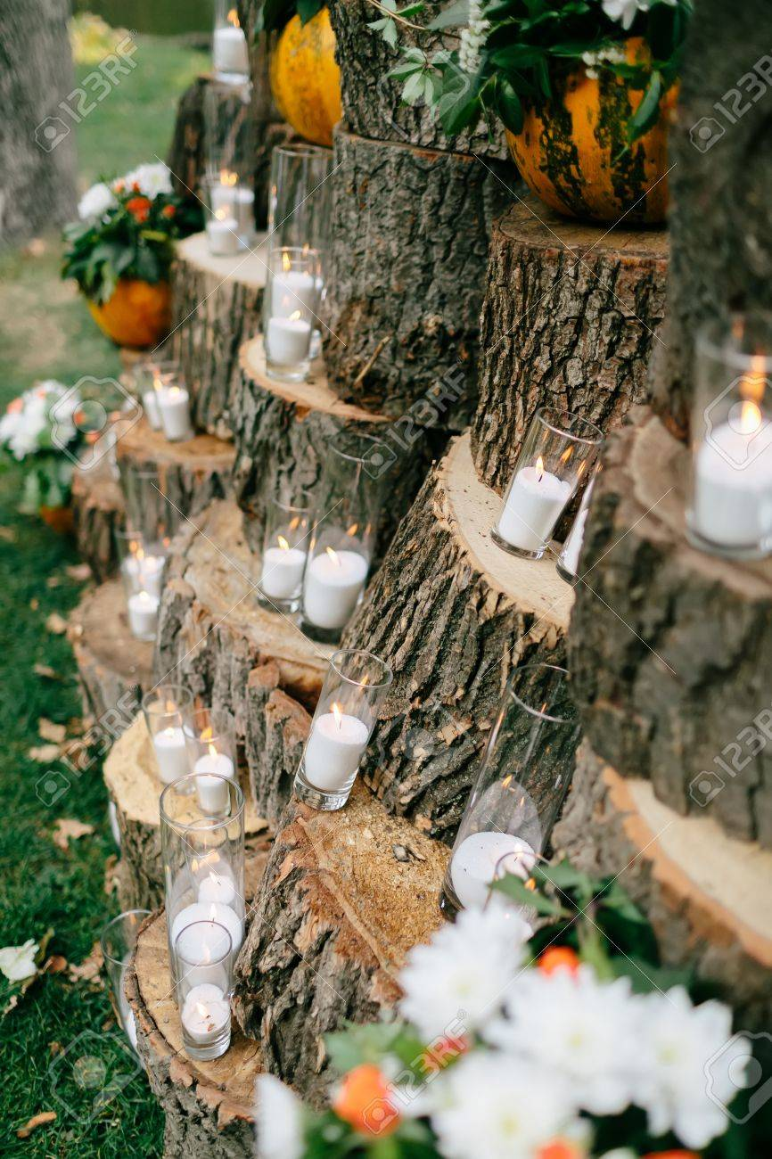 Wedding decorations in rustic style outing ceremony wedding stock photo wedding decorations in rustic style outing ceremony wedding in nature candles in decorated goblets junglespirit Image collections