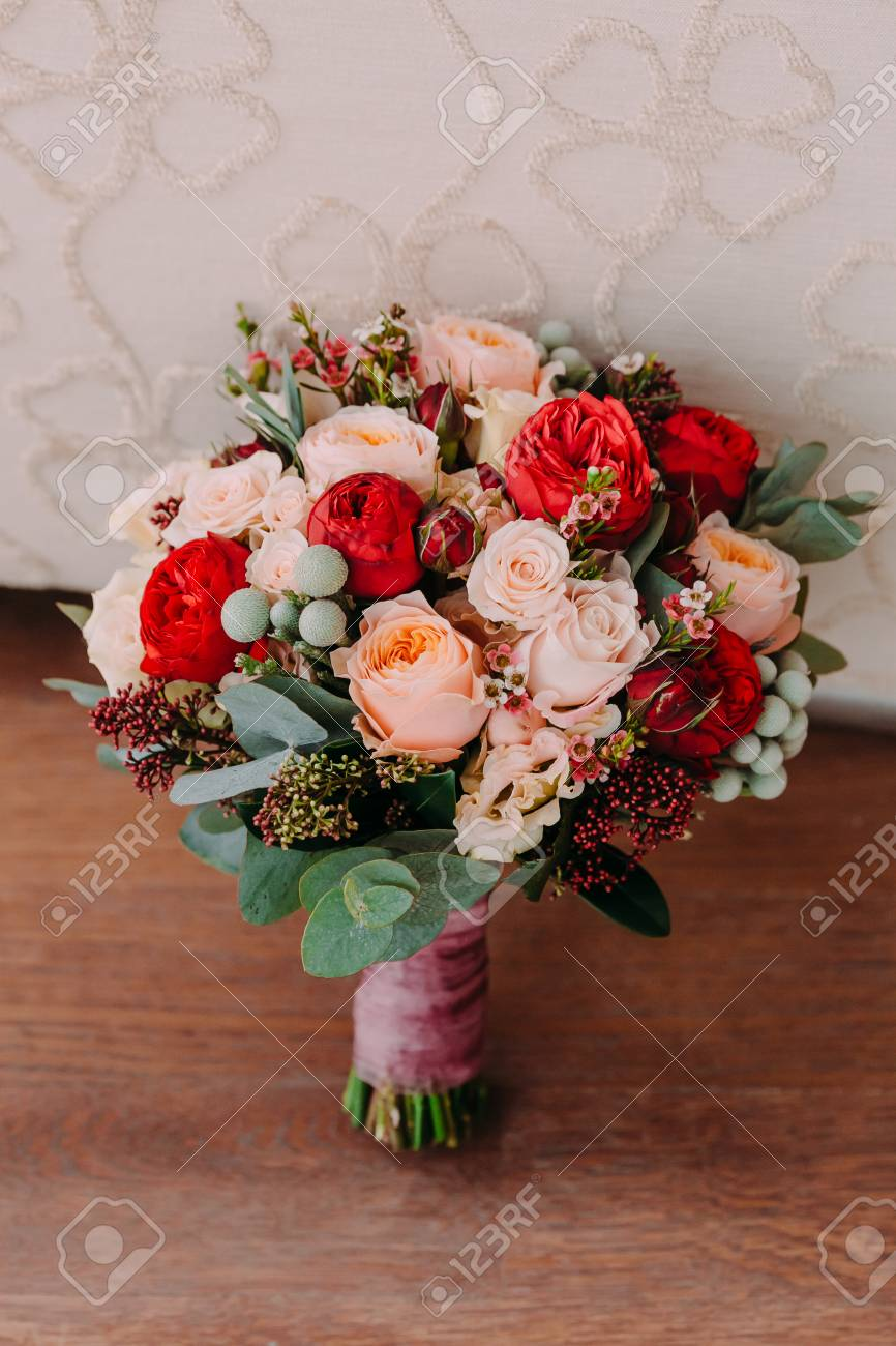 Beautiful Wedding Bouquet Of Red Flowers Pink Flowers And Greenery