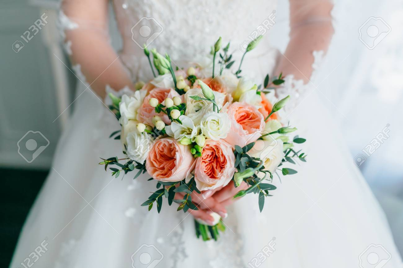 Beautiful Bridal Bouquet With White Roses And Peach Peonies In Stock Photo Picture And Royalty Free Image Image 83349807