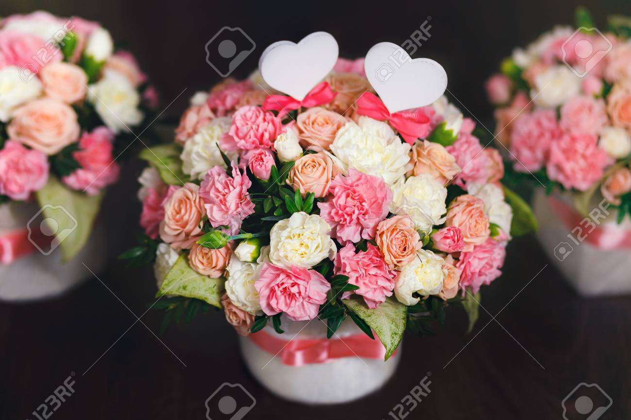 Flower Arrangement Of White And Pink Roses At The Dark Background