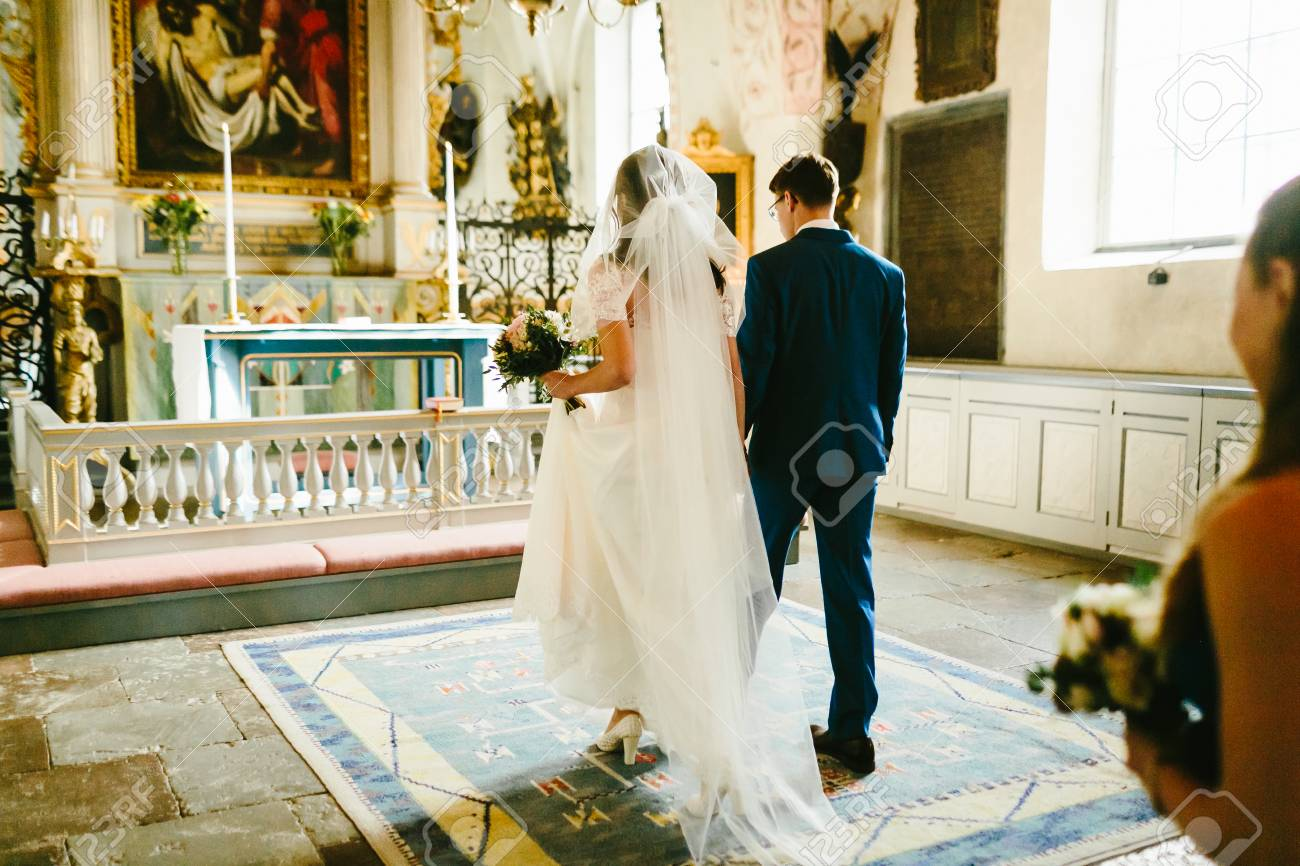 Bride and groom in the church during the catholic wedding ceremony bride and groom in the church during the catholic wedding ceremony artwork stock photo junglespirit Image collections