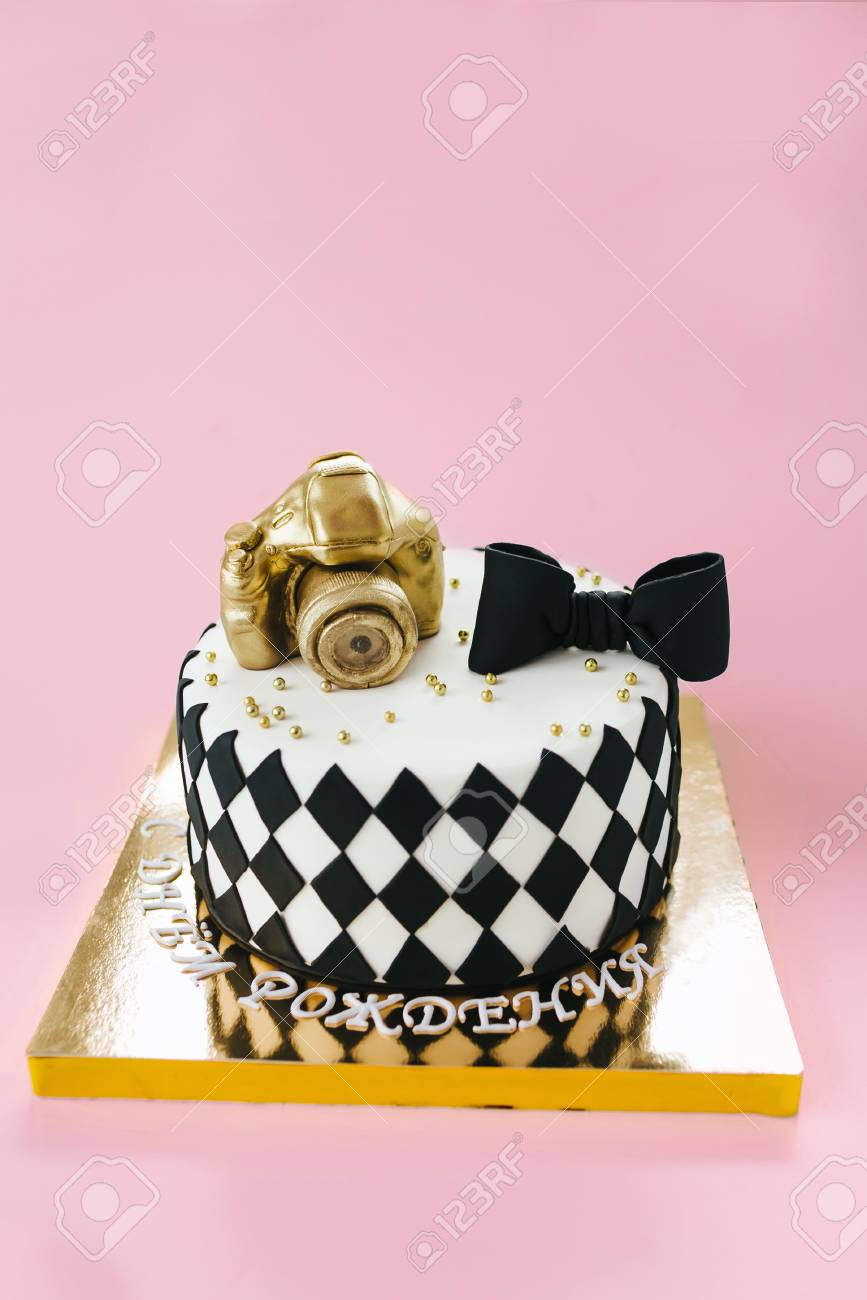 Black And White Birthday Cake For Photographer On Pink Background