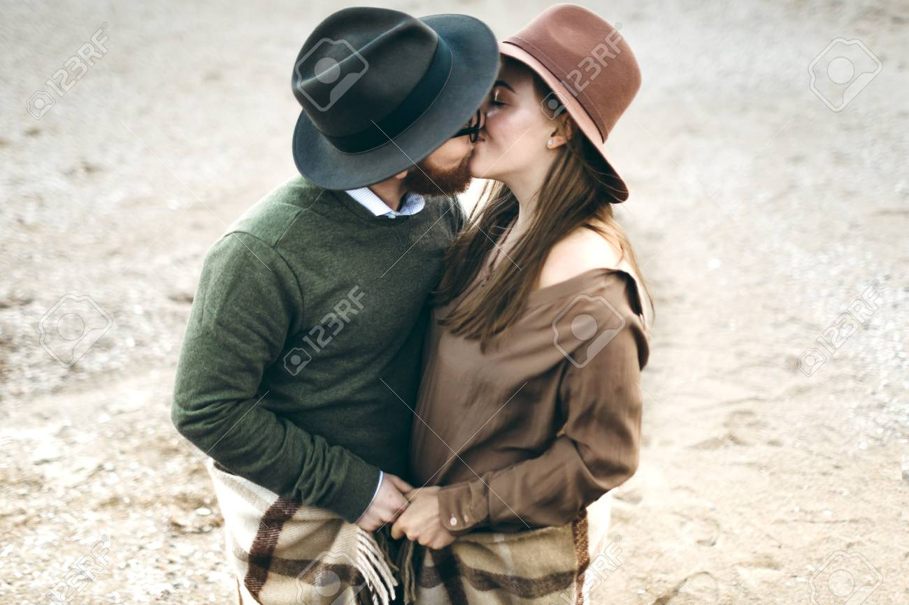 Beautiful Couple of man and woman dressed in country style kissing.  Newlyweds in hats. e145199e6c3
