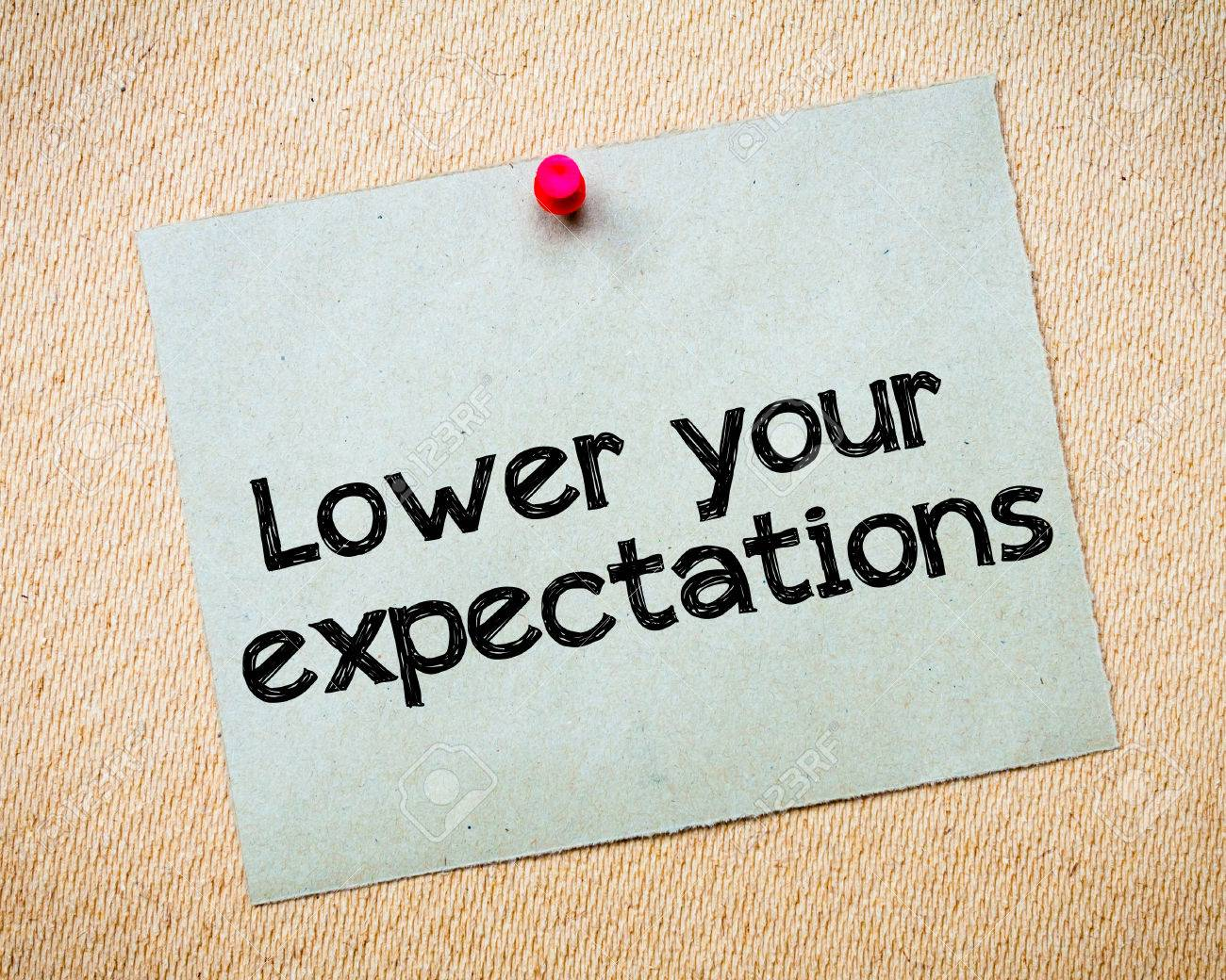 lower your expectations message recycled paper note pinned on lower your expectations message recycled paper note pinned on cork board concept image stock