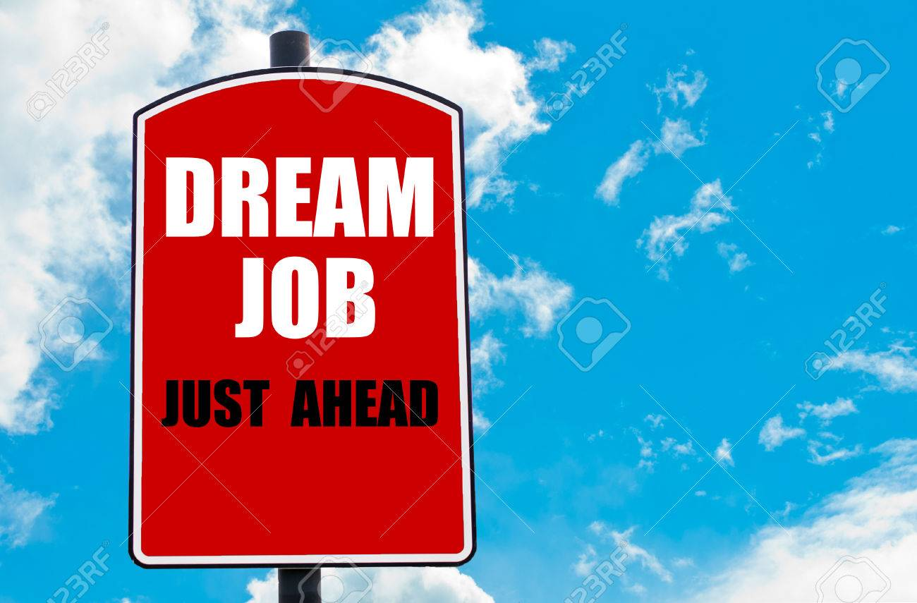 Dream Job Just Ahead Motivational Quote Written On Red Road Sign Isolated  Over Clear Blue Sky