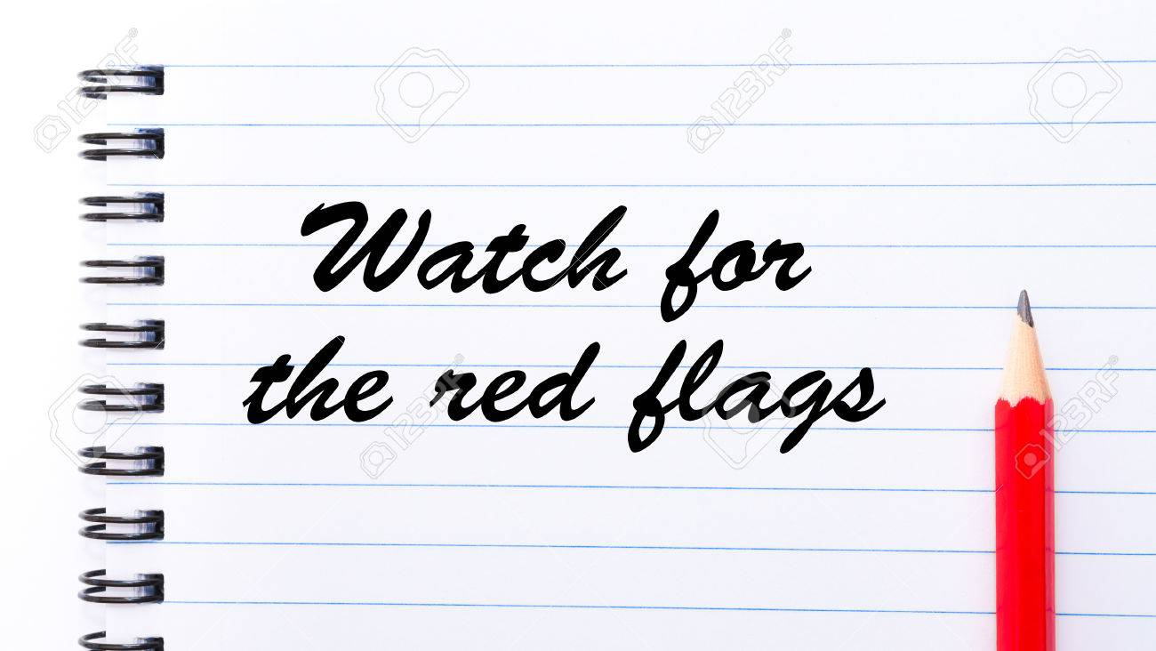 watch for the red flags written on notebook page red pencil stock