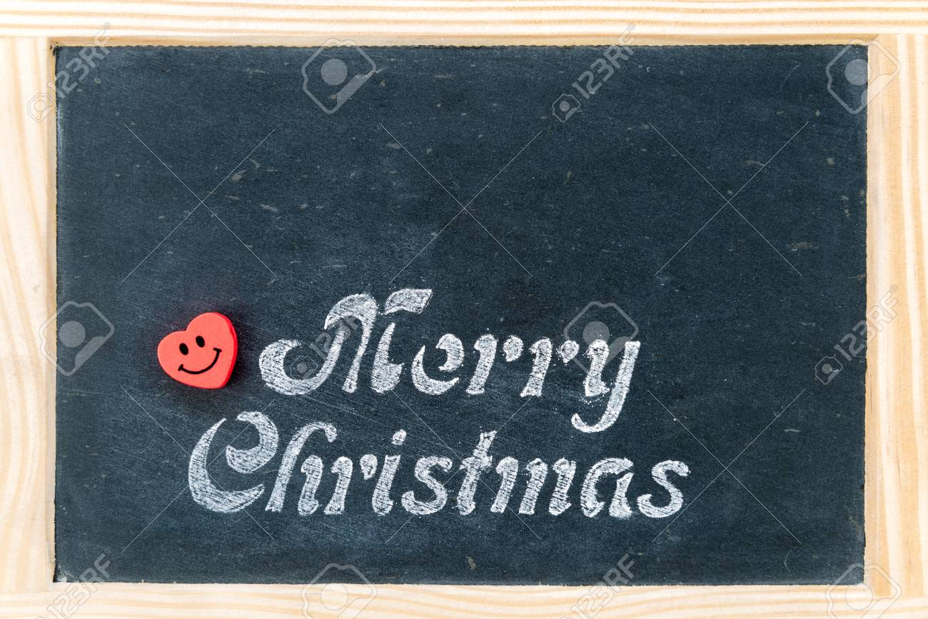 Wooden frame vintage chalkboard with merry christmas message wooden frame vintage chalkboard with merry christmas message and red heart smiling emoticon copy space buycottarizona Image collections