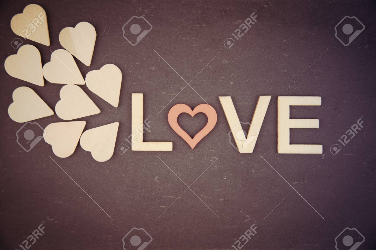 Stock Photo Word Love Created Of Wood Letters Over Vintage Chalkboard Retro Filter Applied Wood Letters Originated Of Wooden Hearts Letter O Replaced