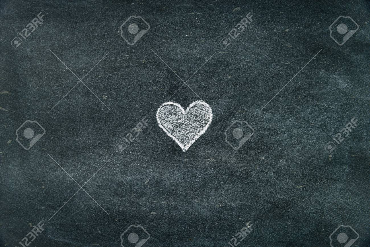 Hand Drawing Heart Shape Symbol Filled With White On Blackboard
