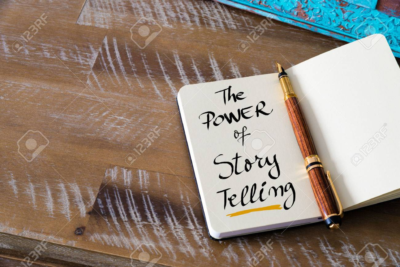 Retro effect and toned image of notebook next to a fountain pen. Business concept image with handwritten text THE POWER OF STORY TELLING , copy space available - 53233247