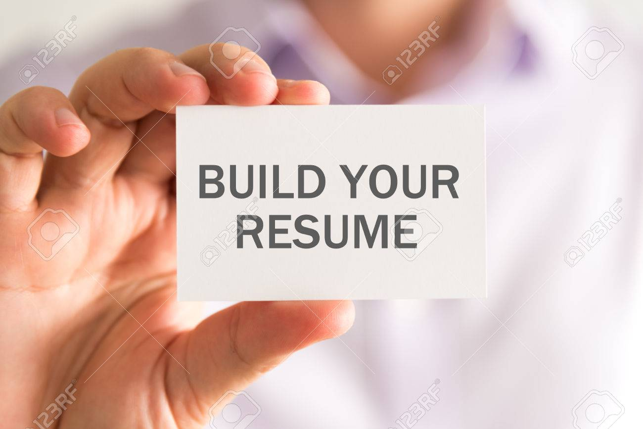 closeup on businessman holding a card with build your resume