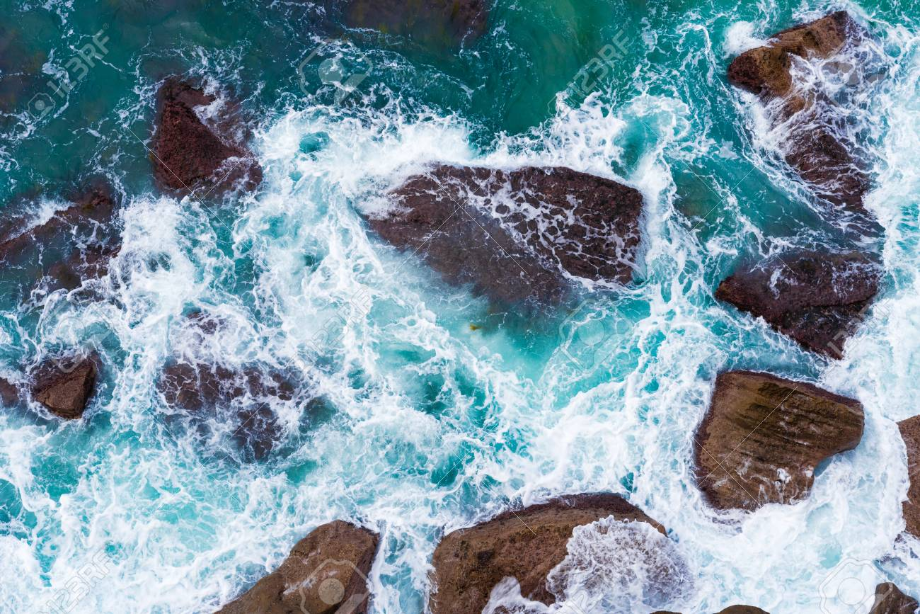 Top Aerial View Of Blue Waves Crashing On Rocky Australian Coastline Stock Photo Picture And Royalty Free Image Image 100326846