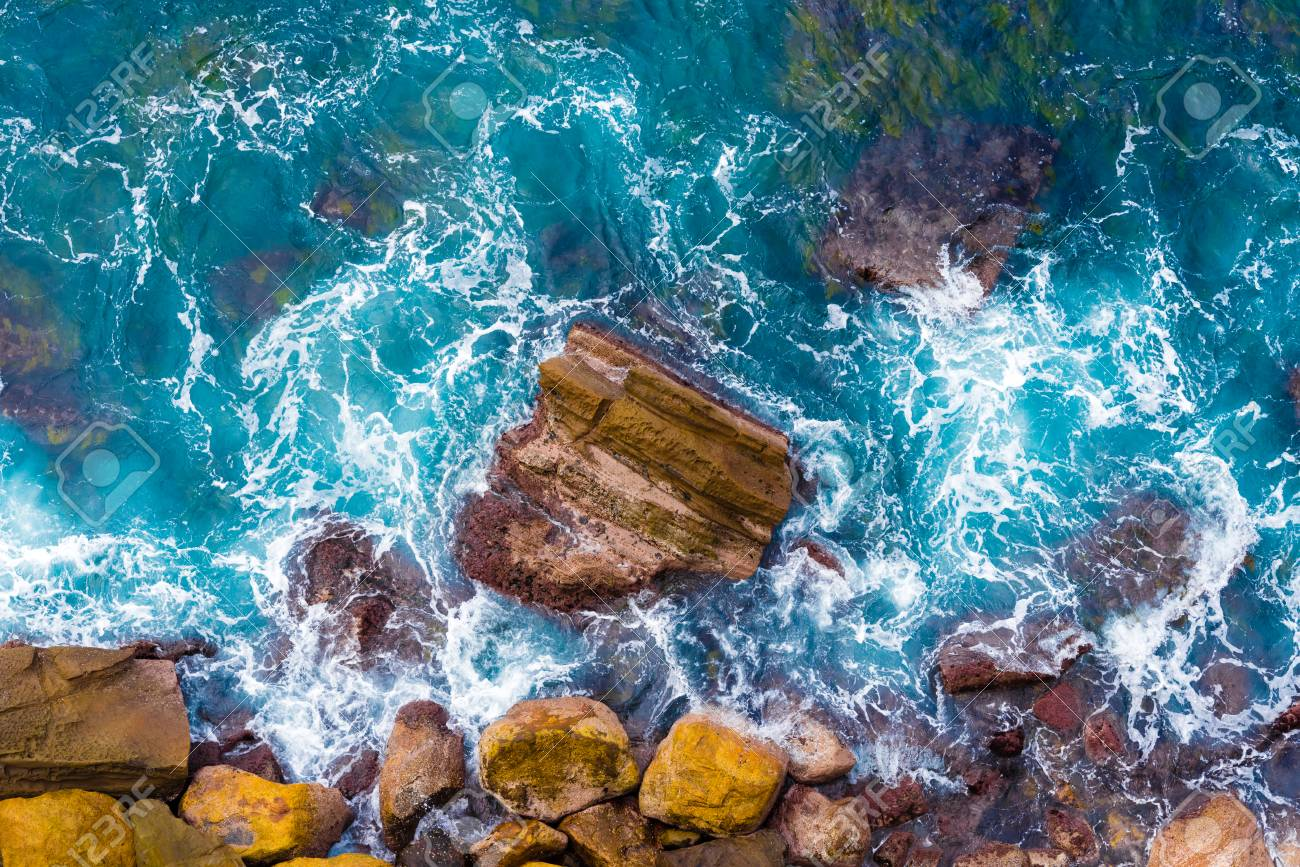Top Aerial View Of Blue Waves Crashing On Rocky Australian Coastline Stock Photo Picture And Royalty Free Image Image 100311467