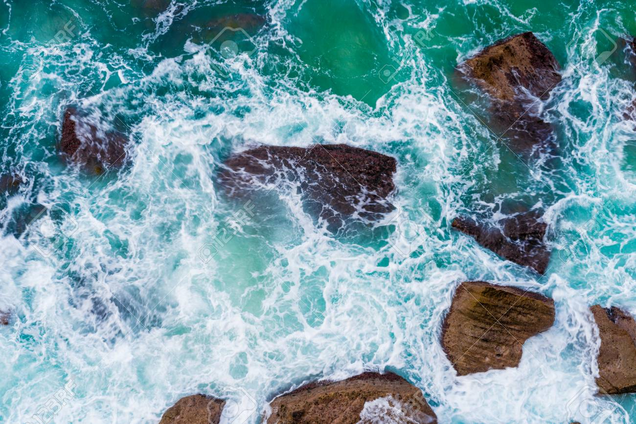 Top Aerial View Of Blue Waves Crashing On Rocky Australian Coastline Stock Photo Picture And Royalty Free Image Image 100311466