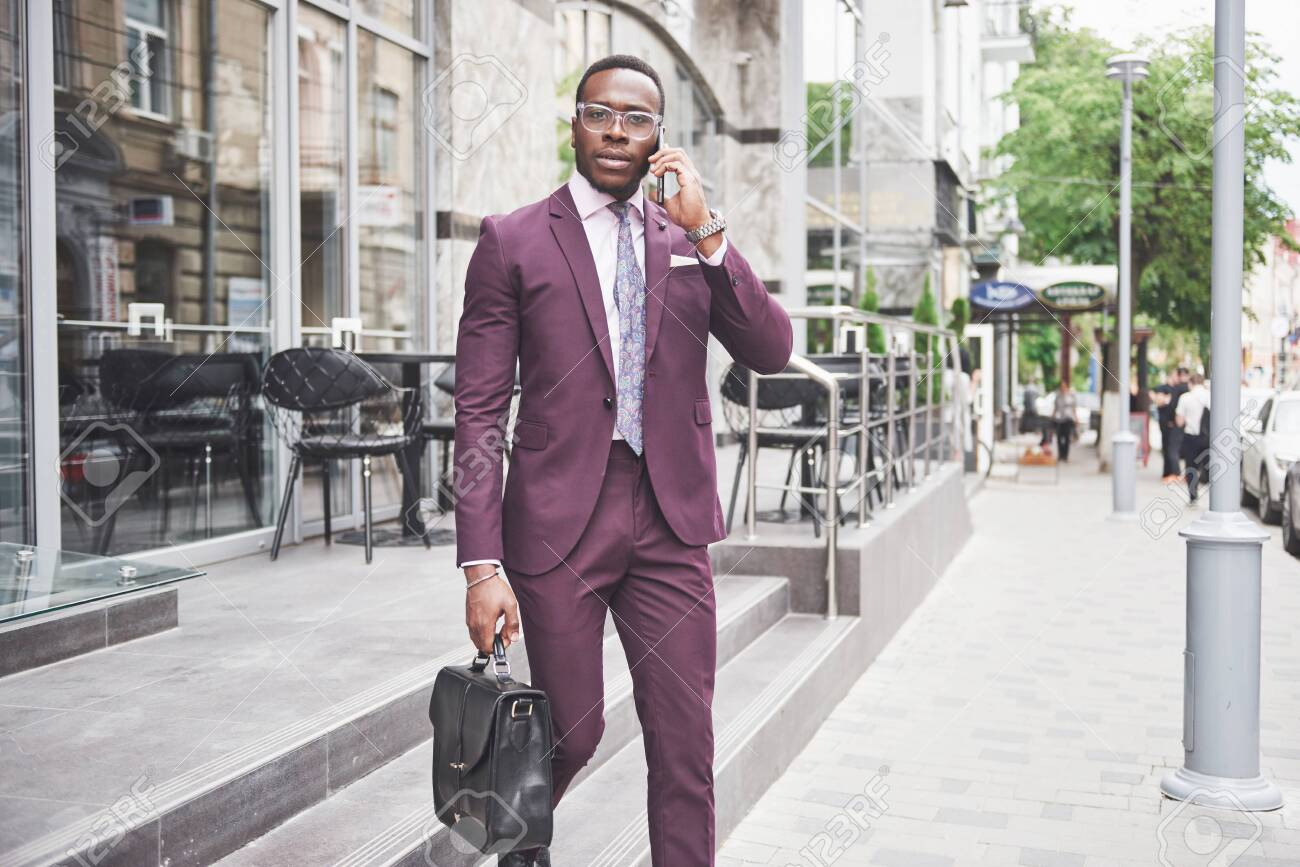 Portrait of a young beautiful African American businessman with a briefcase. Business meeting - 133826419