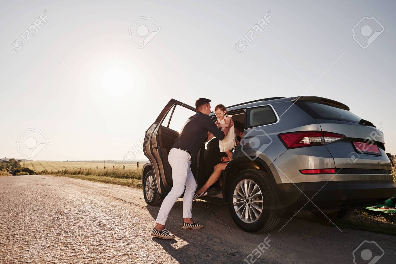 Going out. Beautiful people is in the modern car at their weekends. - 135507329