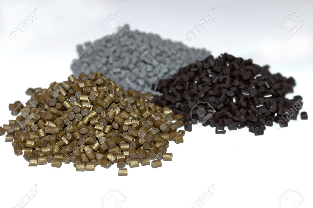 The plastic granules. Dye for polypropylene, polystyrene granules into a measuring container - 85248823