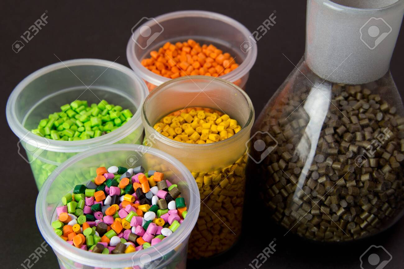 Plastic granules in a measuring container and test tubes in the laboratory. Plastic pellets. Plastic Raw material . BPA FREE - 150324343