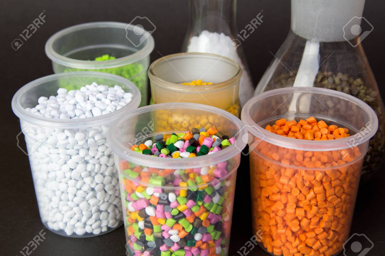 Plastic granules in a measuring container and test tubes in the laboratory. Plastic pellets. Plastic Raw material . BPA FREE - 150324344