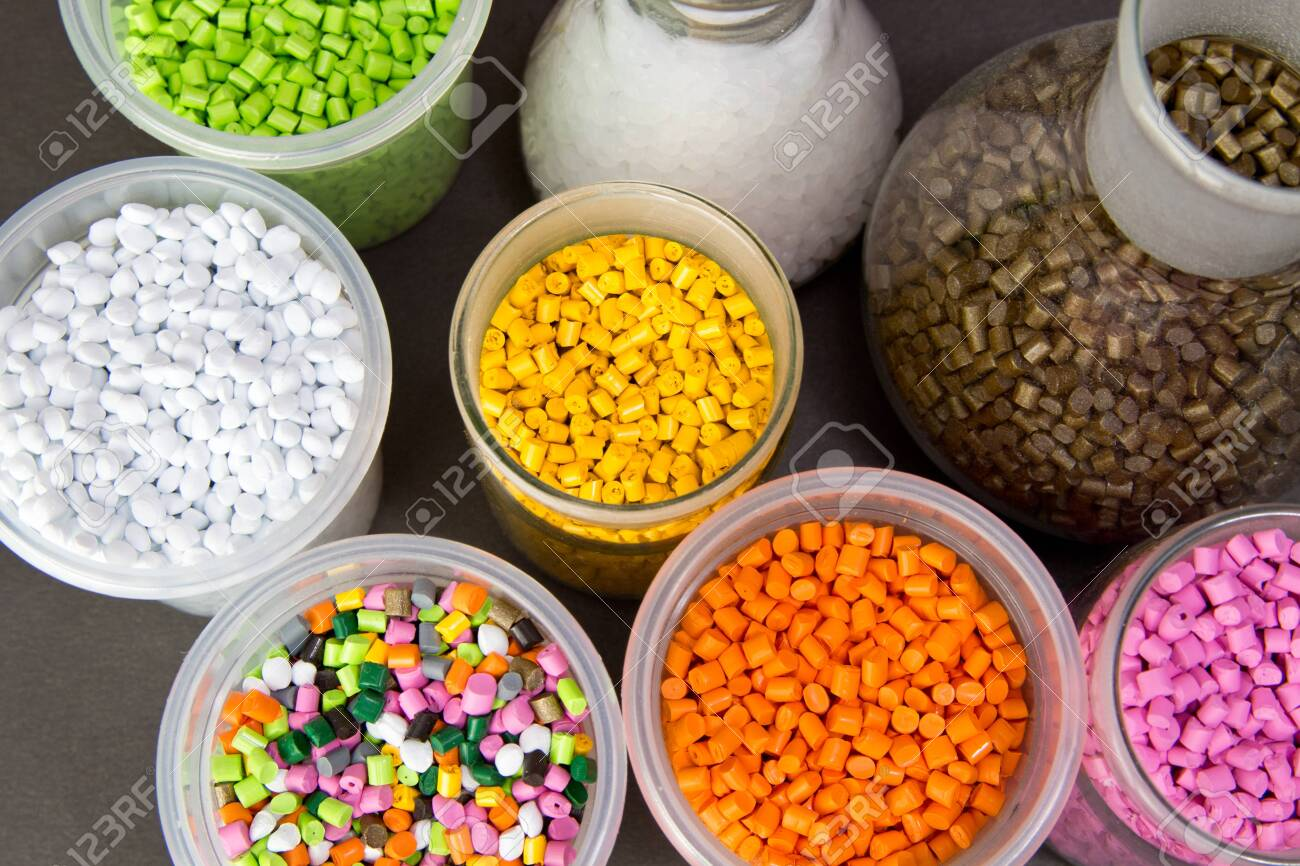 Plastic granules in a measuring container and test tubes in the laboratory. Plastic pellets. Dyes for plastic, polypropylene, polyethylene - 150324346