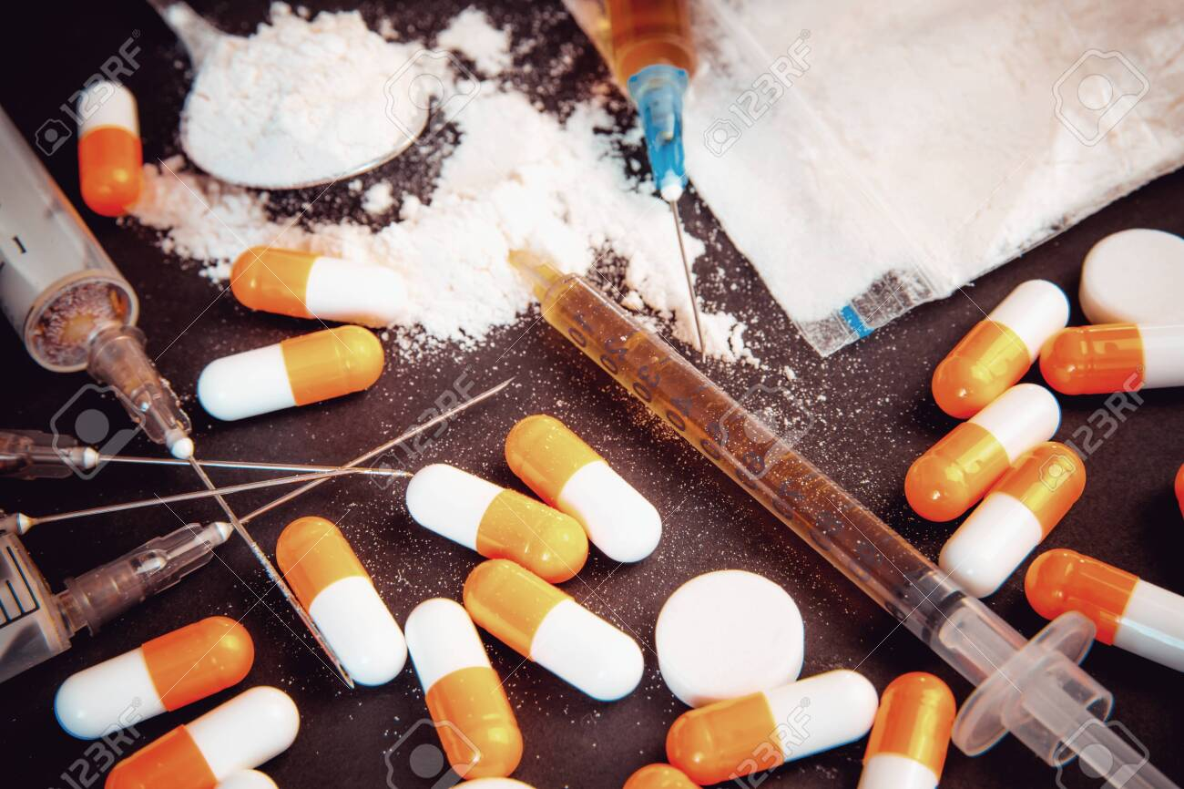 Drug abuse Concept. Opioid epidemic .Opioid Pills. Syringe preparation spoon and prepared the heroin. Stop the use of drugs. - 150324390