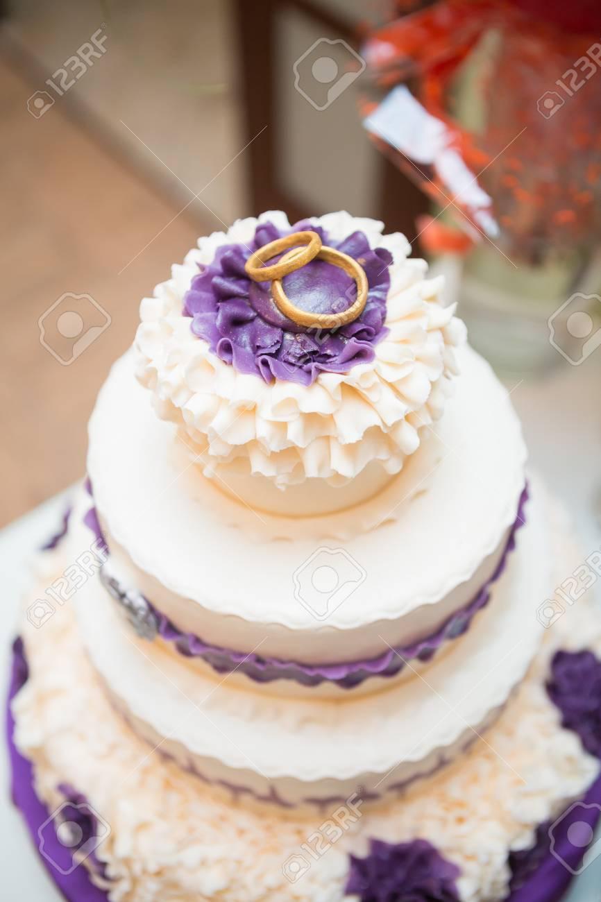 White Multi Level Wedding Cake With Flower Decorations Stock Photo