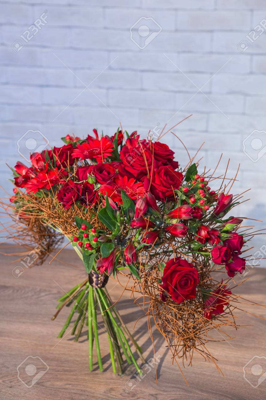 Beautiful Flower Bouquets On A Light Background Of A Brick Stock ...