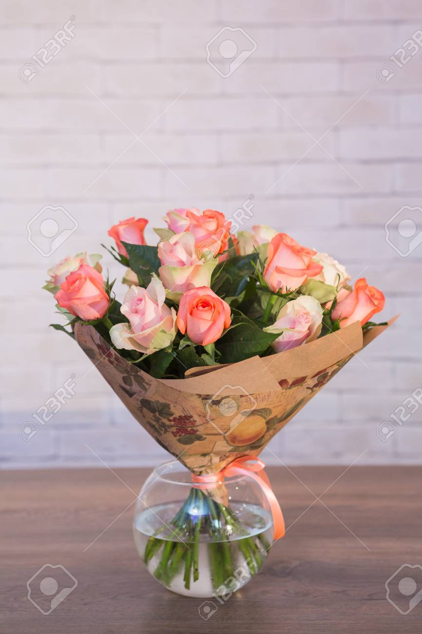 Beautiful Flower Bouquets On A Light Background Of A Brick Stock