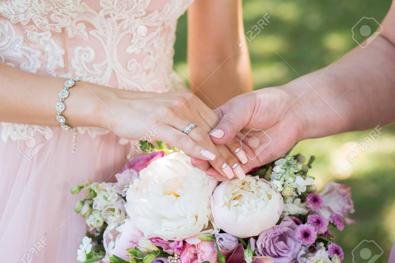 Mother And Daughter Holding Hands On Her Wedding Day Stock Photo ...