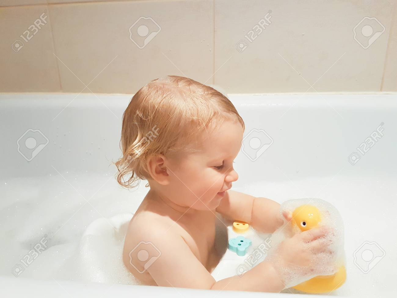 A Little 1,5 Year-old Baby Boy Playing With Toys In A Bubble.. Stock ...