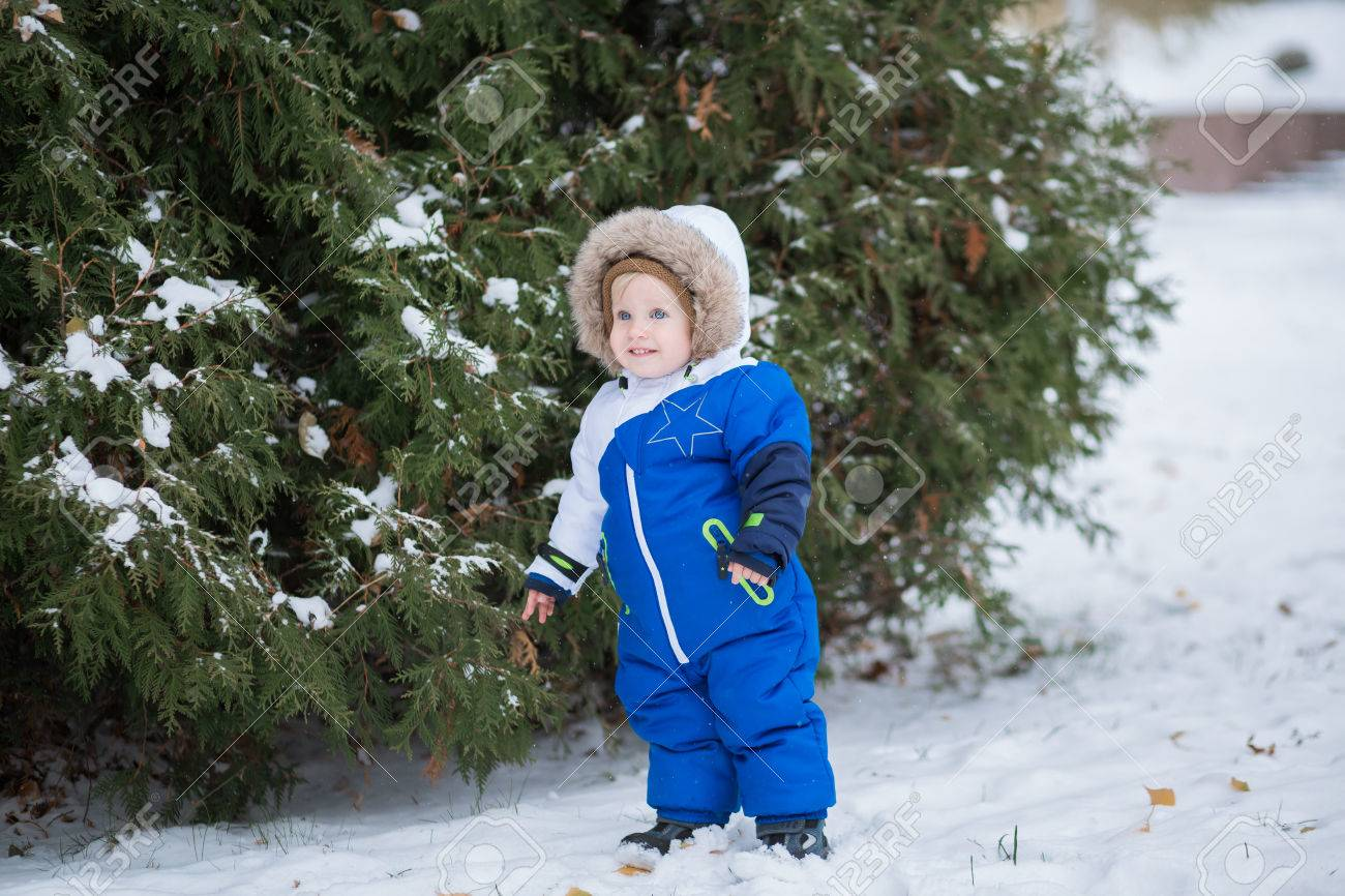 2507649e4 Year-old Laughing Baby Boy In Warm Snowsuit Walking In The Winter ...