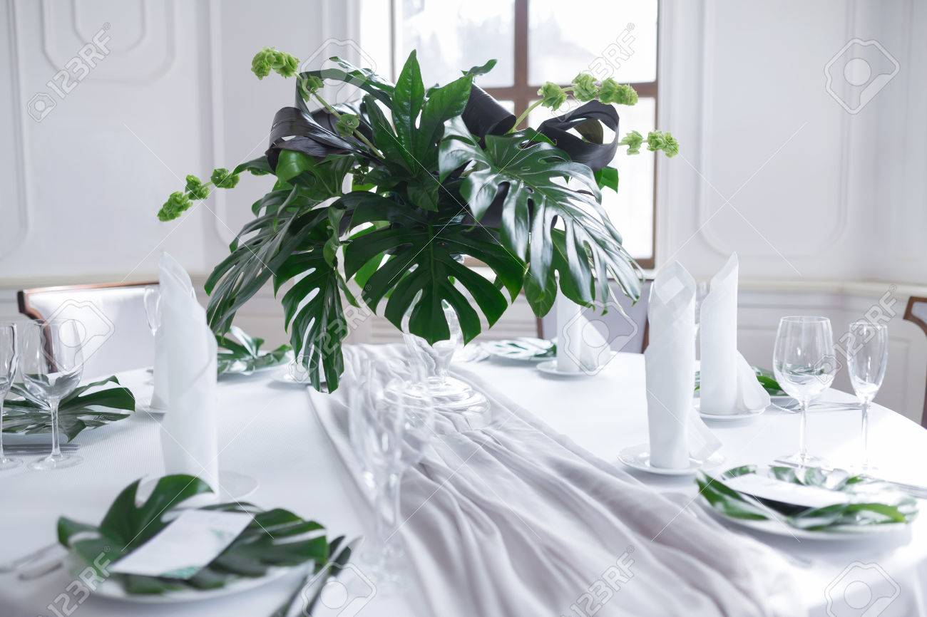 Wedding Served Table Setting With Nature Theme Of Palm Tree Leaves ...