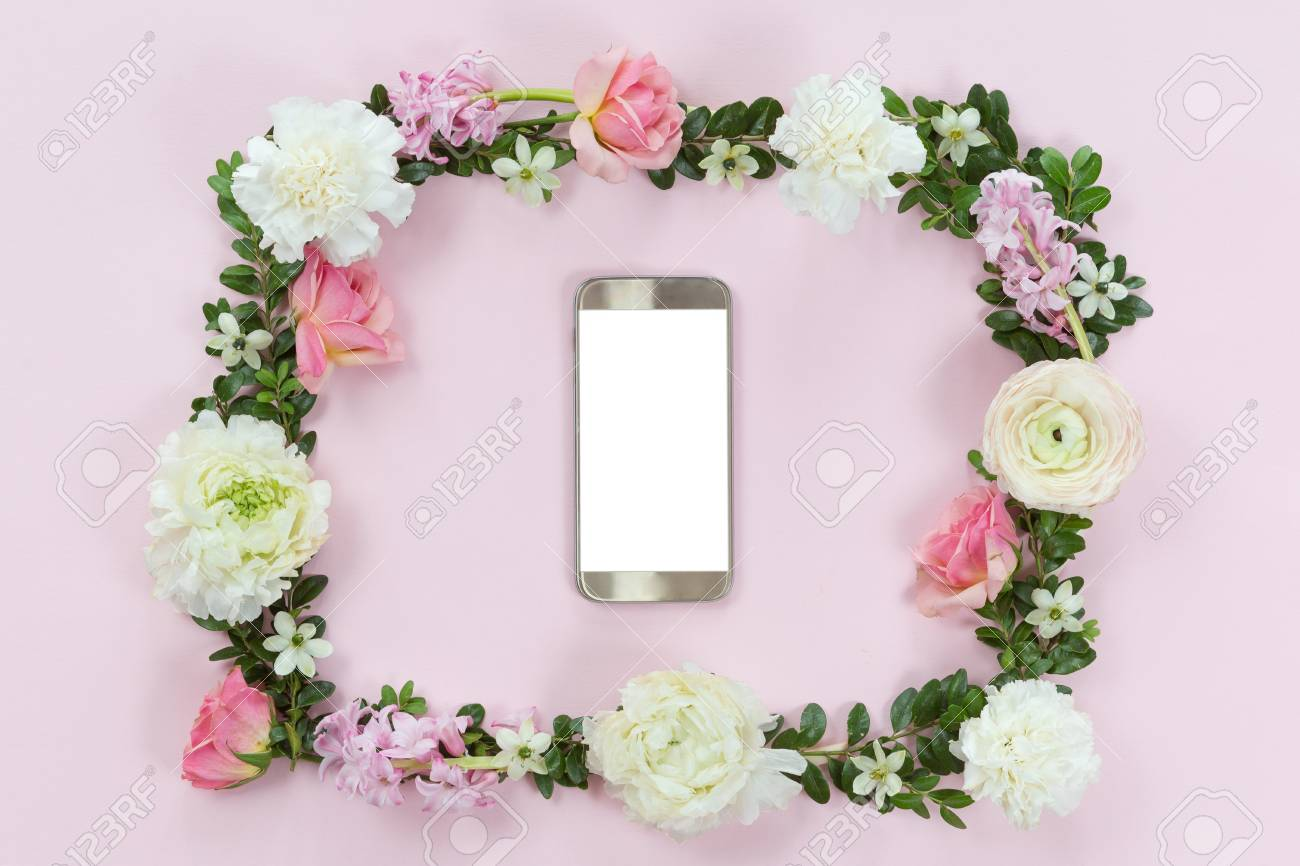 Flower Arrangement On A White Background With A Mobile Phone