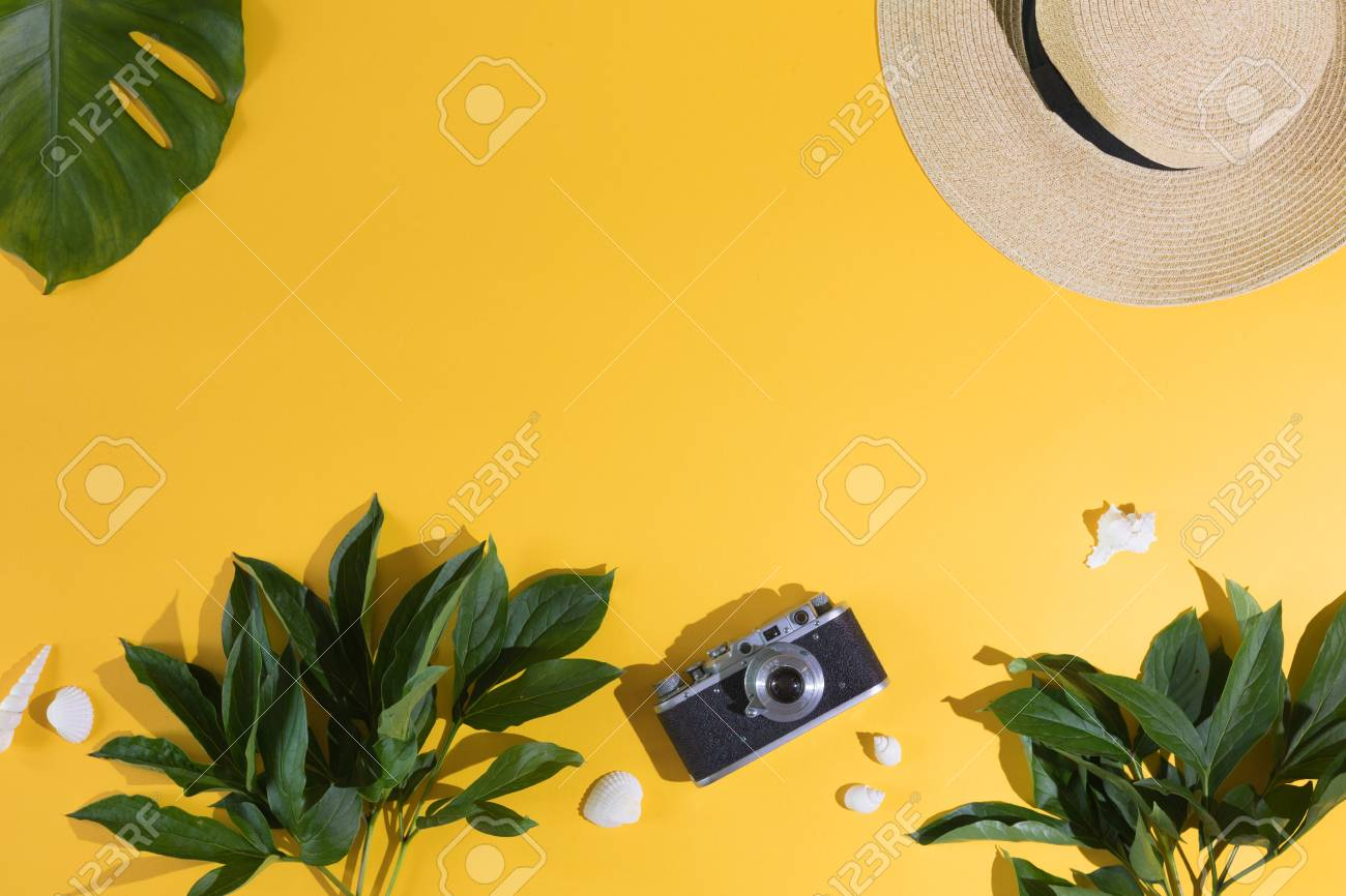 Flat Lay Design Of Yellow Background With Laptop Photo Camera Stock Photo Picture And Royalty Free Image Image 104287455 Green leaf on white sand during daytime. flat lay design of yellow background with laptop photo camera