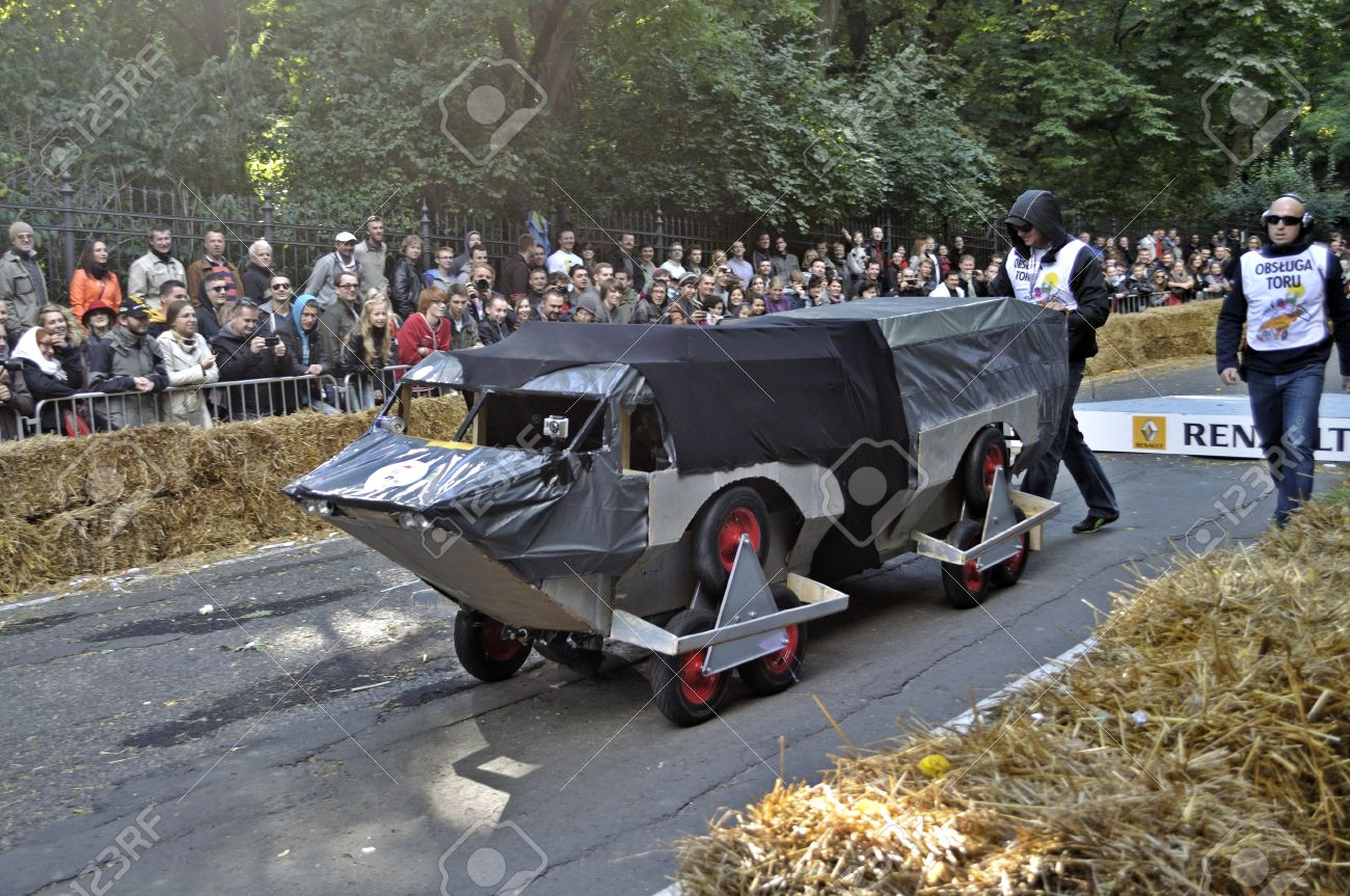 Warsaw, Poland - September 23, 2012 - Unidentified competitor rides his homemade vehicle during the Red Bull Soapbox Race. Stock Photo - 16224482