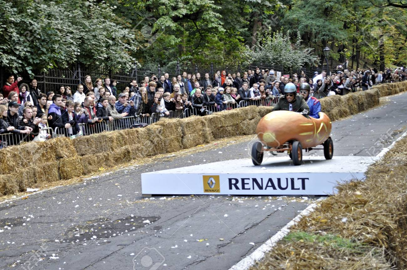 Warsaw, Poland - September 23, 2012 - Unidentified competitor rides his homemade vehicle during the Red Bull Soapbox Race. Stock Photo - 16224478