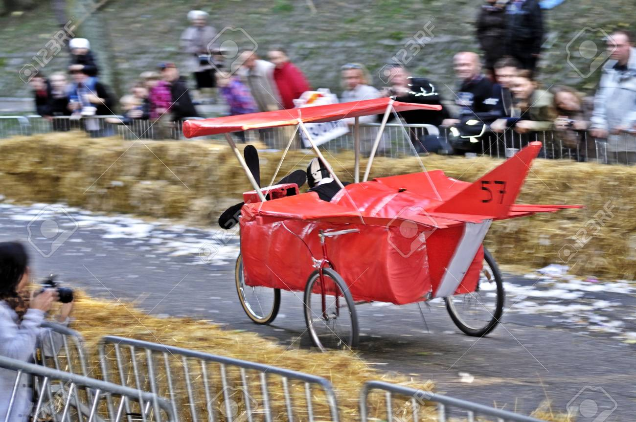 Warsaw, Poland - September 23, 2012 - Unidentified competitor rides his homemade vehicle during the Red Bull Soapbox Race. Stock Photo - 16348301