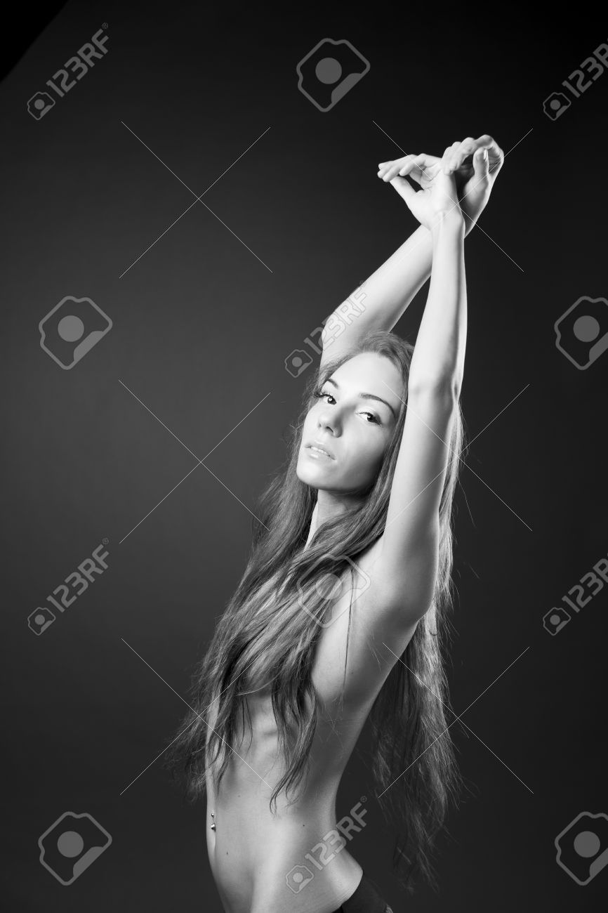 Stock photo young naked girl in studio black and white photography