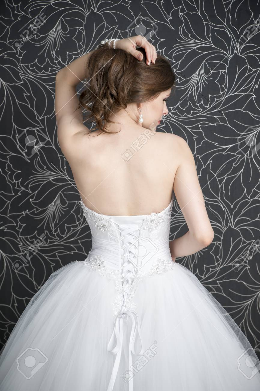 Beautiful Woman In White Wedding Dress With Corset. Back View Stock ...