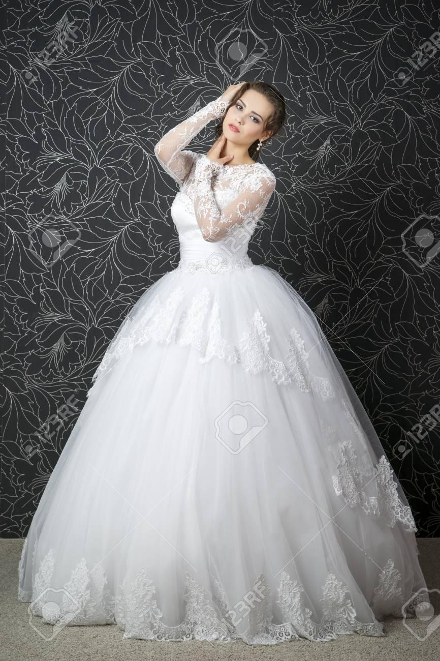 Beautiful Woman In White Wedding Dress. Professional Makeup ...