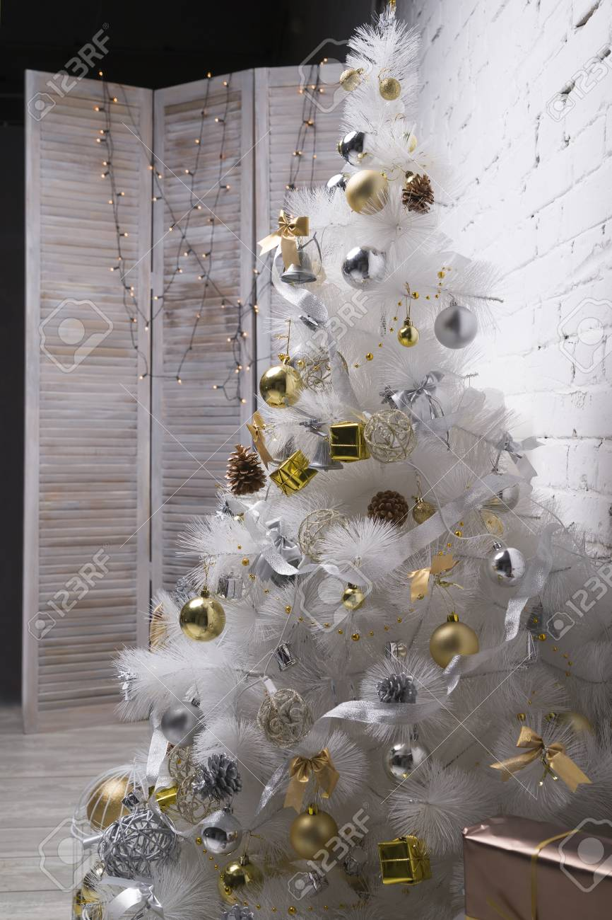 White Christmas Tree With Silver Decorations  from previews.123rf.com