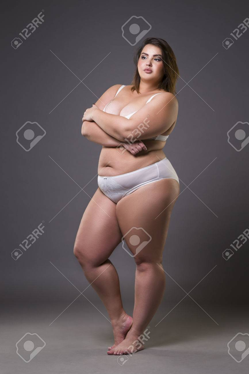 c495b12fa1 Plus size fashion model in underwear, young fat woman on gray studio  background, overweight
