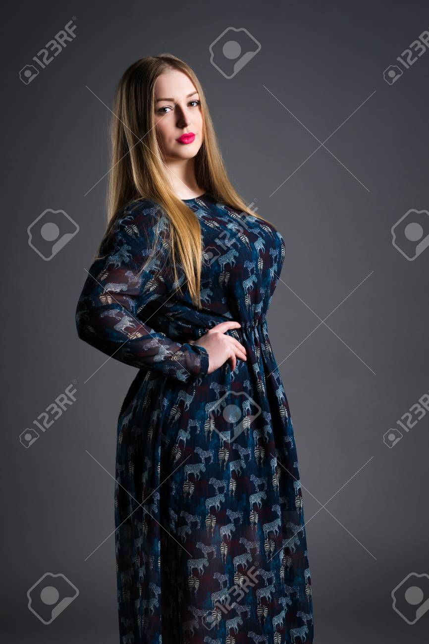 Plus Size Fashion Model In Long Dress Fat Woman On Gray Studio Stock Photo Picture And Royalty Free Image Image 98087320