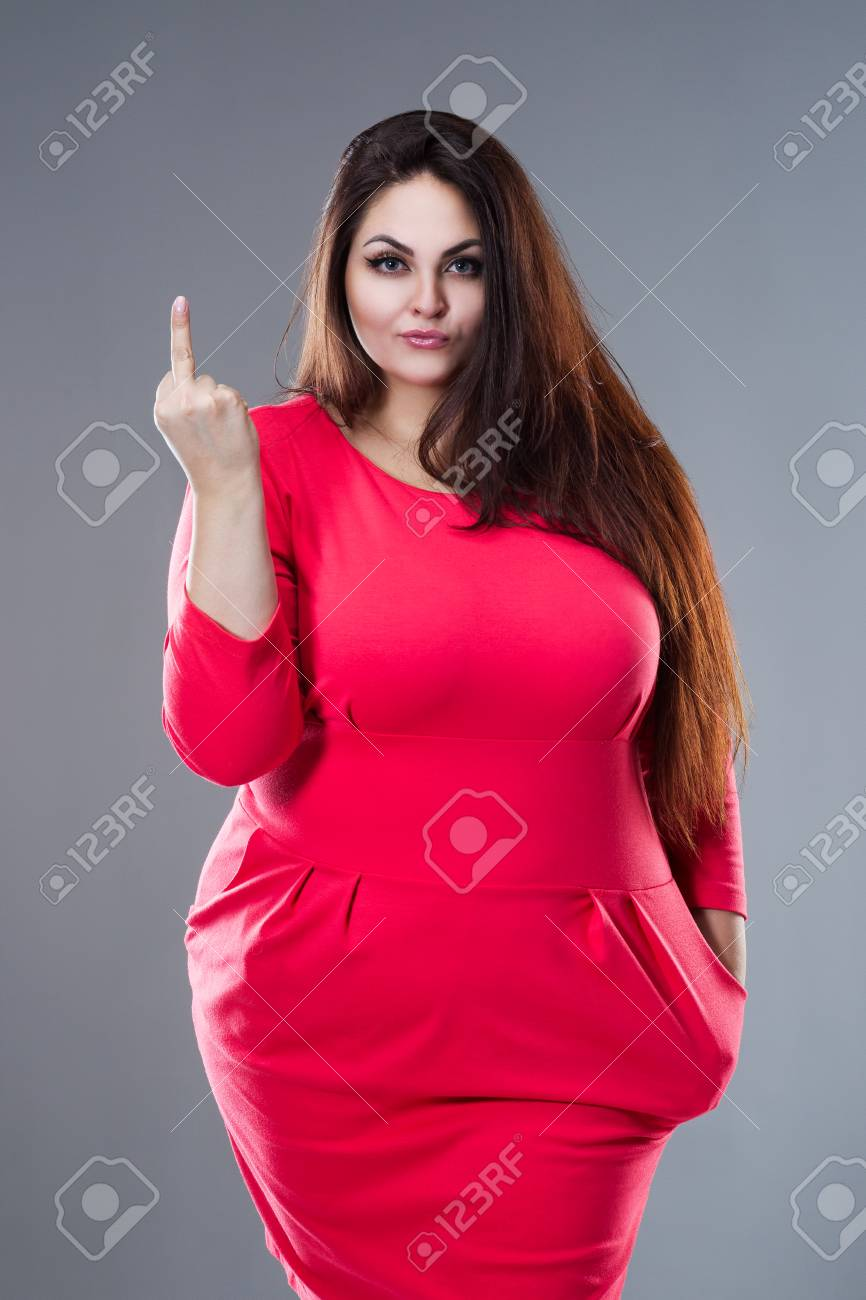 Beautiful plus size fashion model in red dress, fat woman with..
