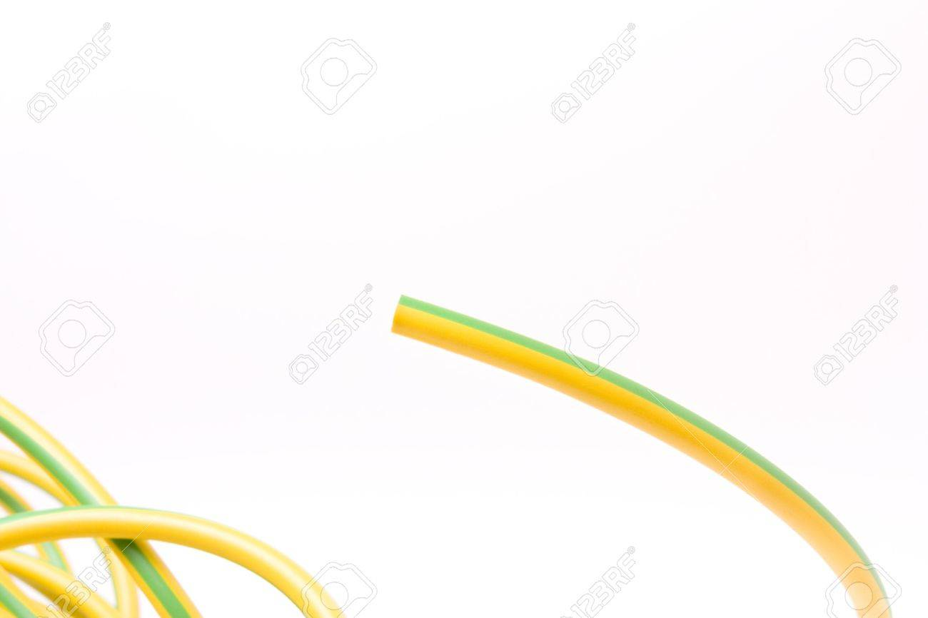 European yellow and green striped earth wire shielding insulation against white background. Stock Photo - 6341045