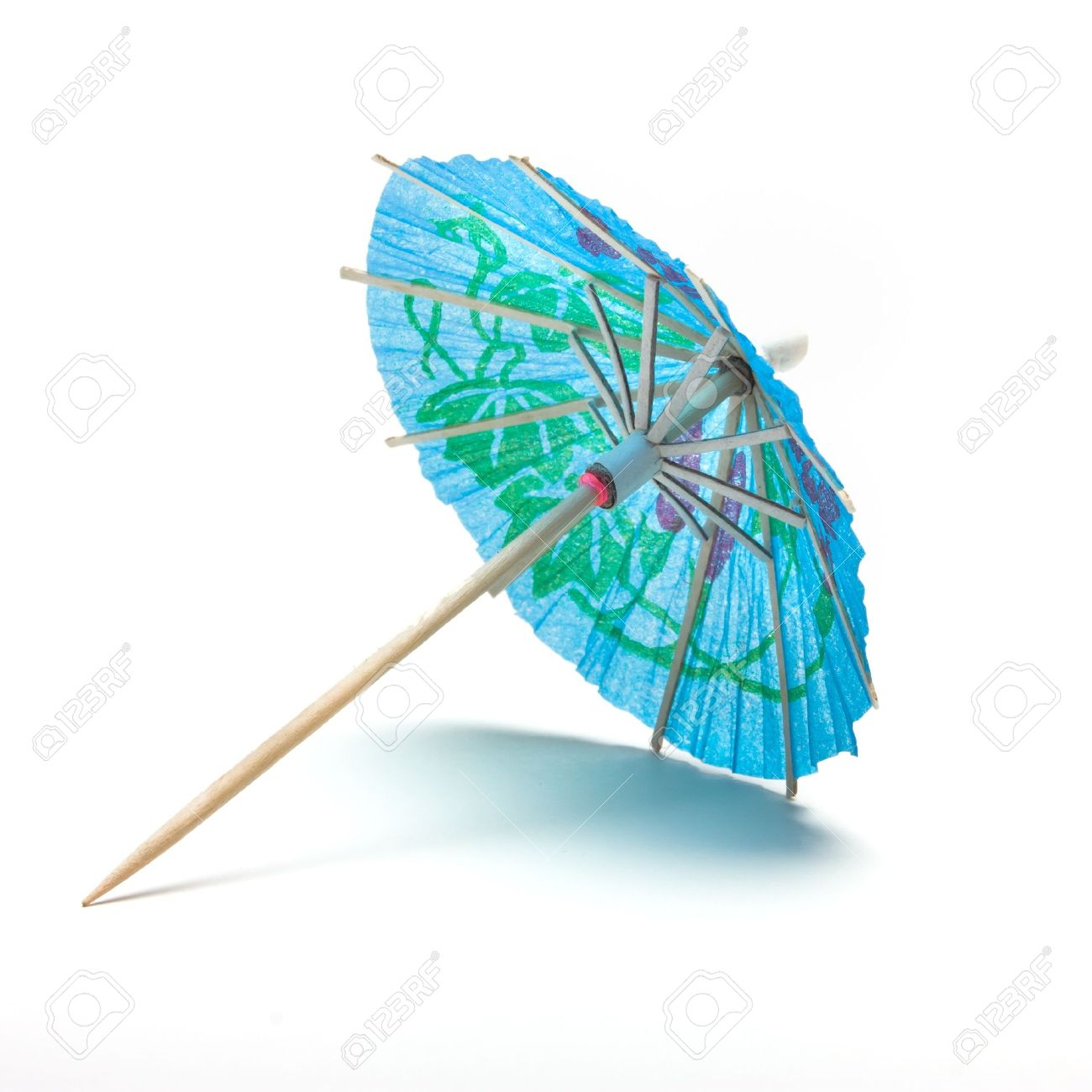 7407018-Cocktail-Umbrella-from-low-perspective-isolated-against-white-background--Stock-Photo.jpg