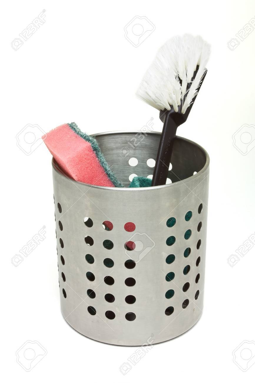 Scouring sponge and brush used for washing dishes in steel container. Stock Photo - 7919259
