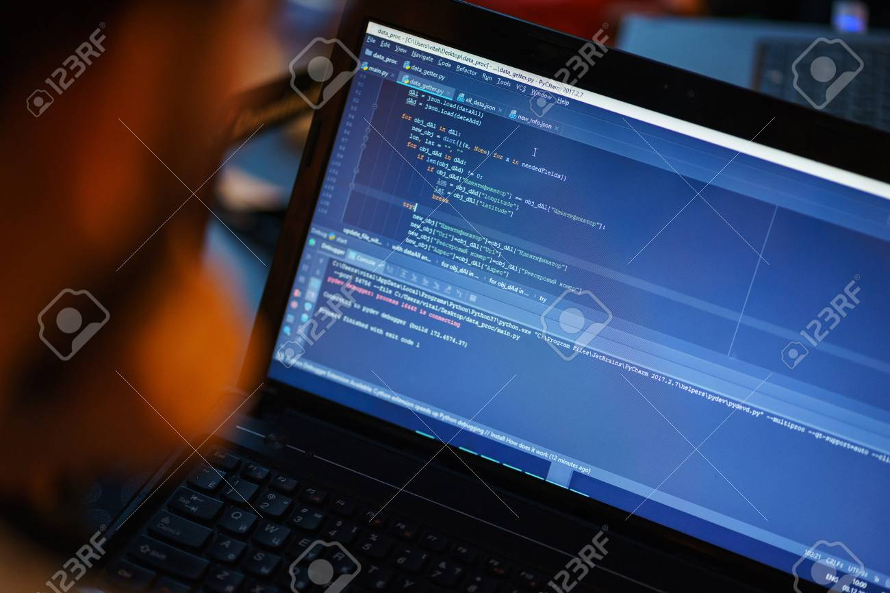 Laptop screen with lines of code  Programmer writes an application