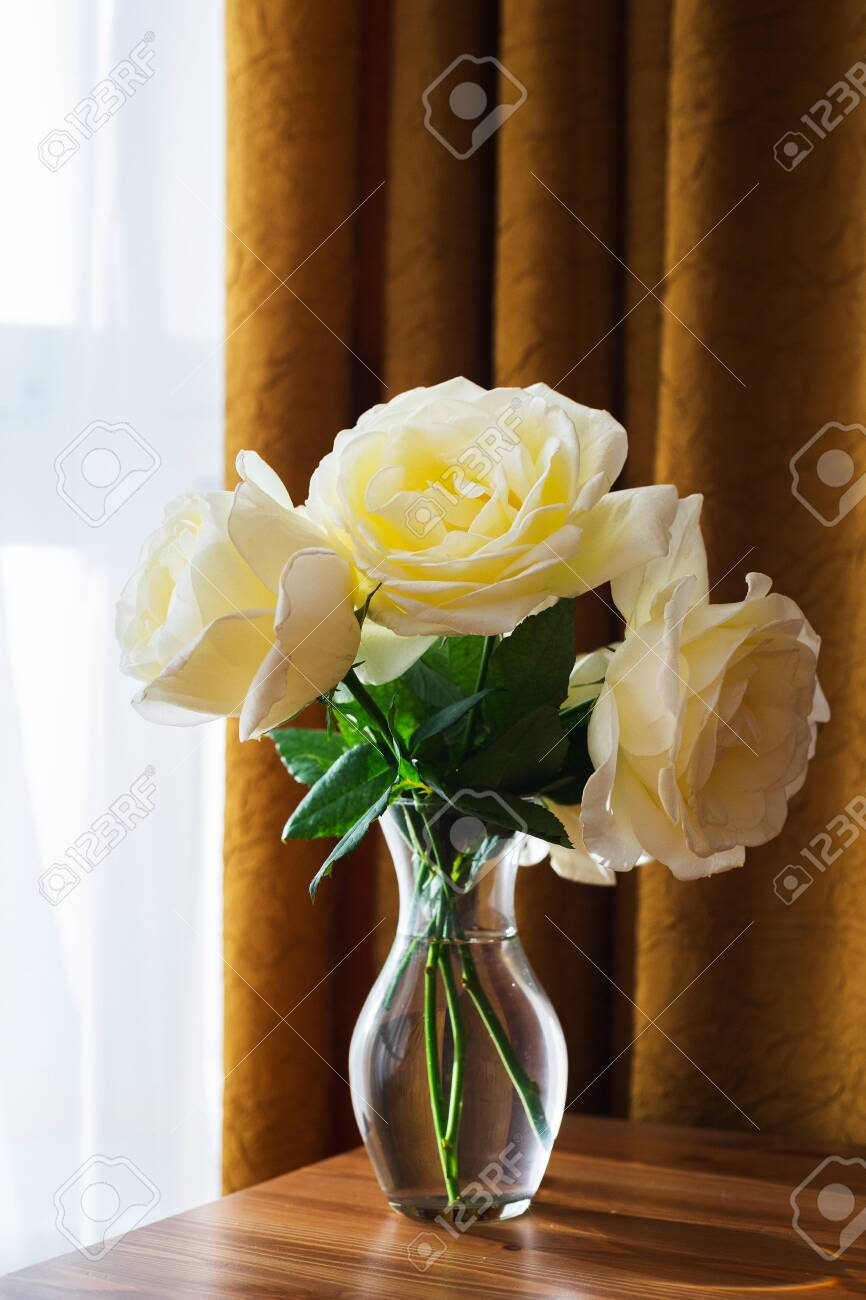 White Beautiful Rose Flowers In A Glass Vase Large Rose Buds Stock Photo Picture And Royalty Free Image Image 129213945